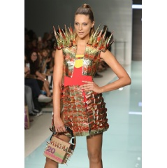 McDonald's makes a splash with McDCouture at Miami Swim Week. Designed by Miami international University of Art and Design Fashion student Lucila Martinez, this Roman military inspired look is sizzling with style.