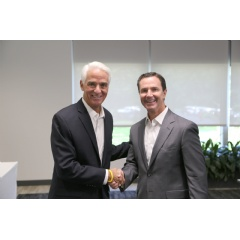 Congressman Charlie Crist (l) meets with Harris Corporation Chairman, President and CEO Bill Brown (r) during a visit to the company's Global Innovation Center in Melbourne, Florida.
