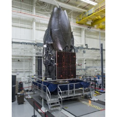 Boeing-built TDRS-M working its way through Boeing's El Segundo satellite factory as it readies for launch. (Boeing photo)